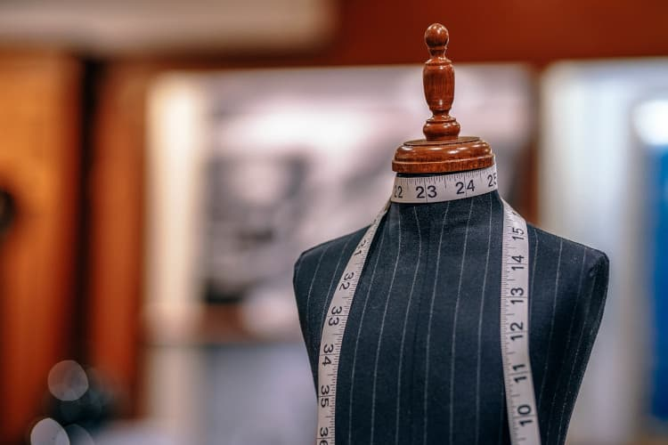 Dress form with measuring tape